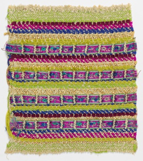 Woven sample with narrow horizontal stripes of varied widths in bright purple, blue, yellow-green, dark red, fuchsia and gold. Warp is off-white bouclé. Wefts are floss, plied and chenille yarns, flat metallic strips, and metallic yarns of varied thicknesses.
