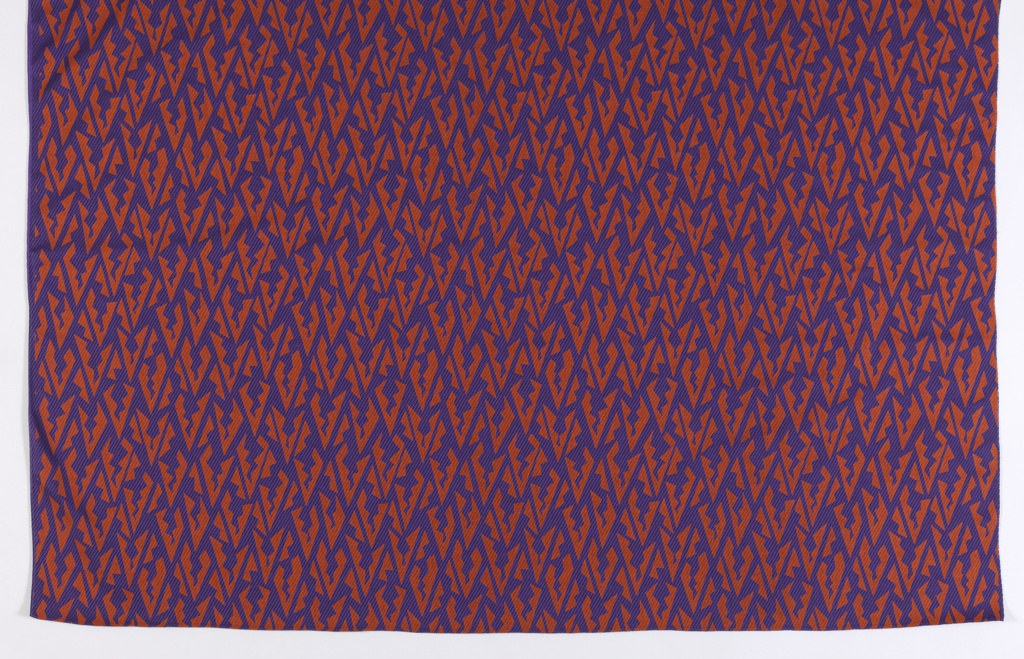Printed length has tightly grouped brown geometrical forms on a purple ground.