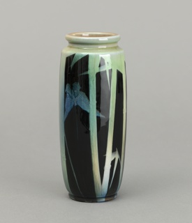 White clay body, thrown. Cylindrical body with short inset neck with thick lip; molded flat foot. Design composed of bamboo stalks and leaves in grayish-green underglaze slip with two pale blue butterflies fluttering behind stalks. Background is black. Allover high glaze. Interior and bottom glazed.