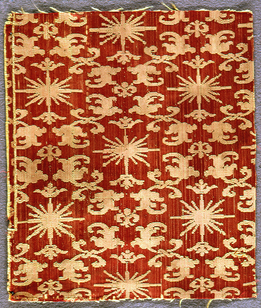 Red and cream-colored fragment with a design of a rayed sun with a crown.