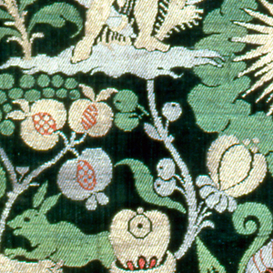 Fragment of green silk damask brocaded in gold and red. Pattern depicts hunter, cupid shooting a bird, rayed head.