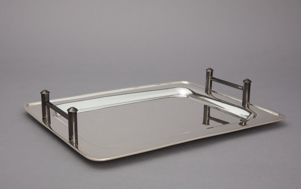 Rectangular tray with slightly elevated rim; black rectilinear on left and right.