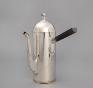 Straight-sided cylindrical coffee pot with domed lid, long curved spout, and straight ebony handle set at right angle to the body.