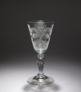 """Large wineglass with a rounded funnel bowl. The stem has a three-ringed knob on a six-sided 'Silezian stem'  and two mereses. Domed foot.   On the bowl a wheel-engraving of a Dutch maiden, an allegorical figure symbolizing the Netherlands. Here she is depicted as the Lady of Liberty, leaning on a  pedestal with the bible and in her right hand a lance with the 'Hat of Liberty'. Behind her the Dutch Lion who holds in one paw a sword; in the other, seven arrows, symbolizing the Seven Provinces.   On the other side of the bowl is depicted the coat of arms of William IV of Orange. The seven coats of arms of the Dutch Provinces meander between (and over) the Lady and the coat of arms of William IV: Utrecht, Holland, Overijssel, Gelderland, Zeeland,  Friesland and Groningen. These arms are connected by a banderole with the inscription CON / CORDIA / RES / PARVAE / CRES / CUNT (""""Through solidarity, small things will flourish""""). This was the device of the Republic of the Seven United Provinces. On the foot a decoration of stylized flowers and leaves."""