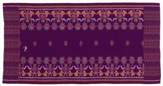 Purple sarong with floral side borders and geometric bands at both ends in red, green, orange and un-dyed white. Metallic wefts used in one inch intervals in borders.