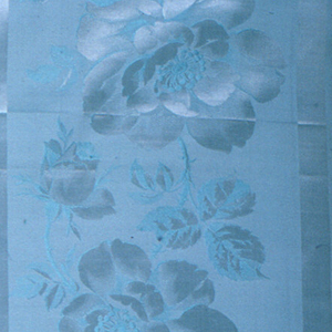 Sample of light blue with a ground of wide vertical stripes in ribbed plain weave separated by narrow satin stripes. Ribbed stripes have large-scale roses in satin weave.