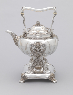 Kettle of squat globular form with reeding, wavy rim, squared curved handle with ivory insulators, spout with chrysanthemums and foliage; domed and reeded lid with flower bud knop. Stand with vertical elements heavily decorated with chrysanthemums and leaves, on square base with burner and four foliate feet.