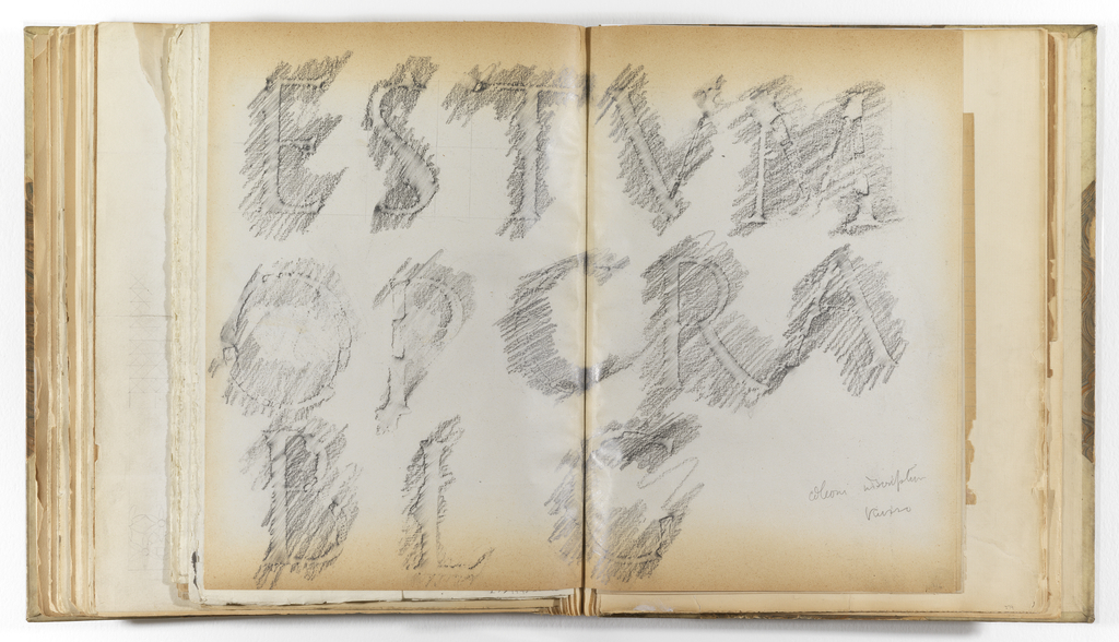 Horizontal sheet folded and tipped into binding depicting three rows of letters that have been rubbed from an inscription sculpted in stone.  First row: ESTVM; second row: OPCRA; third row: BLG.