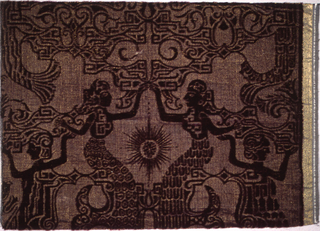 "Deep purple velvet with Indonesian ""wayang"" figures. One of the wefts is a gold colored metallic thread."