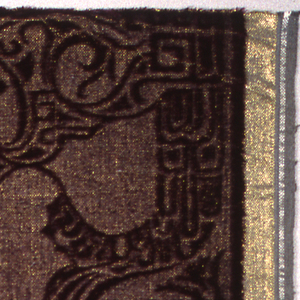 """Deep purple velvet with Indonesian """"wayang"""" figures. One of the wefts is a gold colored metallic thread."""