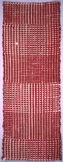 A handwoven sample with color/weave effect in red and white.