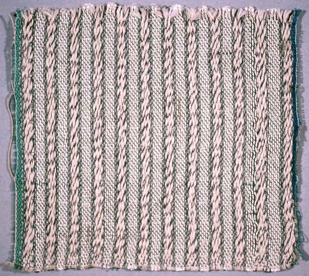 Raised weft effect in two shades of white and pale grey.