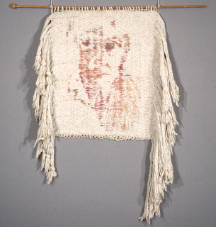 Off-white hanging with image of a face in shades of red and orange. Woven to be rotated 90 degrees and hung from a stick put through the loops of wefts at the selvedge on one side.