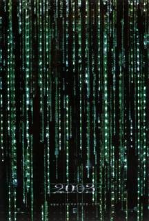 "On black background, a rain-like blanket of vertical running digital tableaux, streaming numbers and letters in neon green. At lower center, the number ""2003"" takes shape horizontally, followed by ""www.thematrix.com"", and three logos of the sponsoring companies."