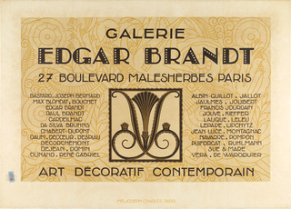 Printed in brown and cream with black lettering, the central image of a curvilinear wrought iron motif is balanced on either side by text. The name EDGAR BRANDT dominates the upper section. The text and image are superimposed over curving tan and white designs that suggest flowers.