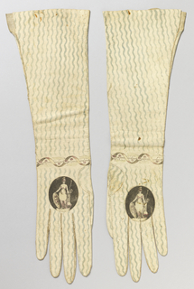 Pair of women's long white kid gloves with wavy green lines hand-painted down the length of the arm. At the wrist, a printed band of a serpentine ribbon intertwined with flowers, and on the back of each hand a printed medallion with a female figure in classical dress with a helmet, spear and shield.