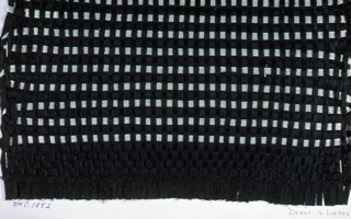 Sample with a warp of black ribbon. Weft is black ribbon with silver metallic ribbon alternating in the weft.