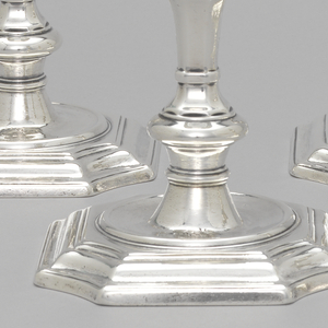 Set of four George II Irish table candlesticks, each with square molded base with incurved corners, stepped moldings with convex circular center, supporting baluster shaft with round knop and octagonal shoulder; vase shaped socket.