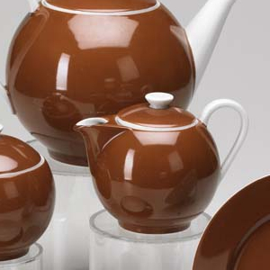 Cup: reddish brown exterior and white interior with loop curved white handle; saucer: reddish brown interior and white exterior.