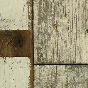 Pattern simulates planks of wood, layed end to end. The planks contain nail holes, scuffs, and remnants of paint mostly in off-white colors.