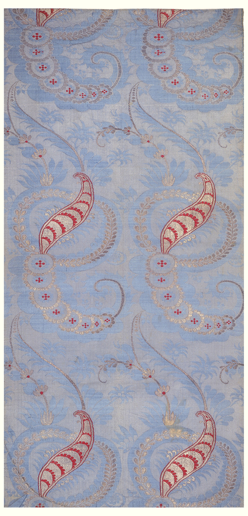 Pale blue damask brocaded with red silk and silver metallic yarns, in feather-like shapes and floral scrolls in the 'bizarre' style. Both selvages present.