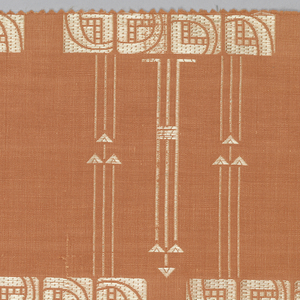 Furnishing textile with offset groups of squared blossoms on long slender stems in pale yellow on a peach-colored ground.