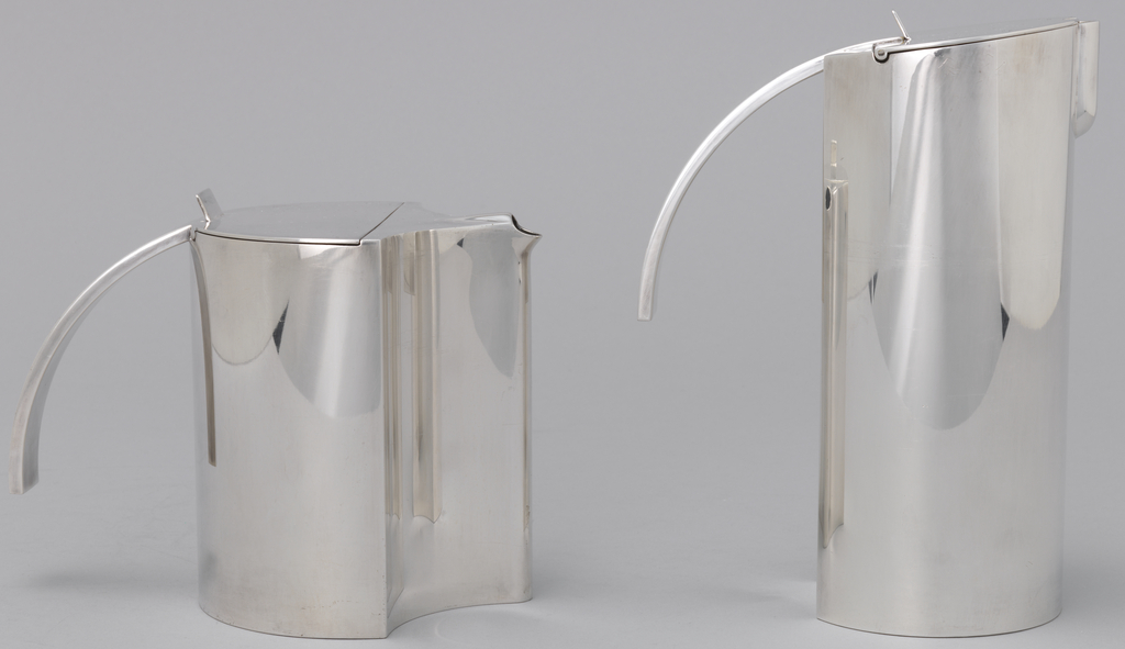 Shiny silver-plated cylindrical coffee pot with hinged lid and vertical thumb piece. Handle projects from hinge to form half arch. Spout engaged to form streamlined projection at top quarter of body.