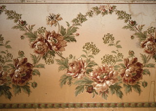 Flitter frieze with floral design, peony in old rose and maroon, green and rose branches, formal border in green and rose, tan ground. Motifs outlined in metallic gold mica flakes.
