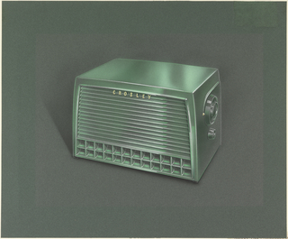 Rectangular radio design featuring front speaker with horizontal grill at top and two rows of cubes at bottom.  Right hand side of radio features tuning knob and volume control.
