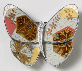 Abstract butterfly form comprising simple, curved body studded with small diamonds, flanked by wings with polychrome lacquer, mother-of-pearl, egg shell, and gold decoration inspired by 'Kodai-ji makie' using Chinese bell flower motif.