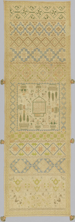 Bands of geometric patterns with a central square containing text and symbols. Several tassels sewn on edge.