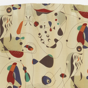 Length of printed fabric with an all-over repeating design of abstract organic forms in black, blue, green, orange, red, gray and tan on a white ground.