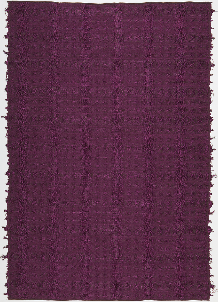 Two panels, one dark brown and one violet, with a psychedelic weft-float weave. The pattern is based on costumes that Indians wear when they practice religious rituals and drink a hallucinogenic herb, Yagé.  According to tradition, this helps them see and remember their ancestors.