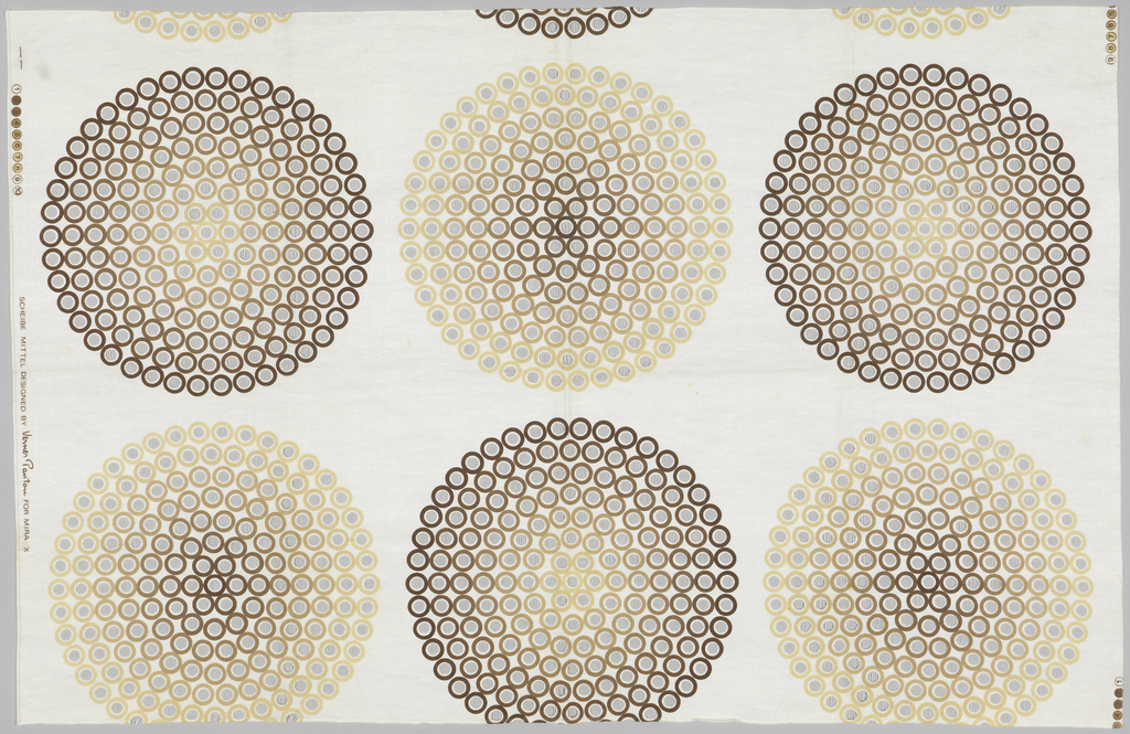 "Brown and light brown circles printed on a white background with smaller ""burn-out' circles within the larger circles."
