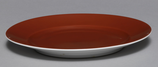 Plate with reddish-brown interior and white exterior.