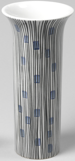 Tall cylindrical form with everted rim; white ground decorated with vertical black lines interspersed with small blue rectangles.