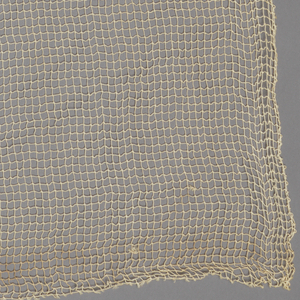 Simple open square grid of natural-colored yarns, giving sheer effect.