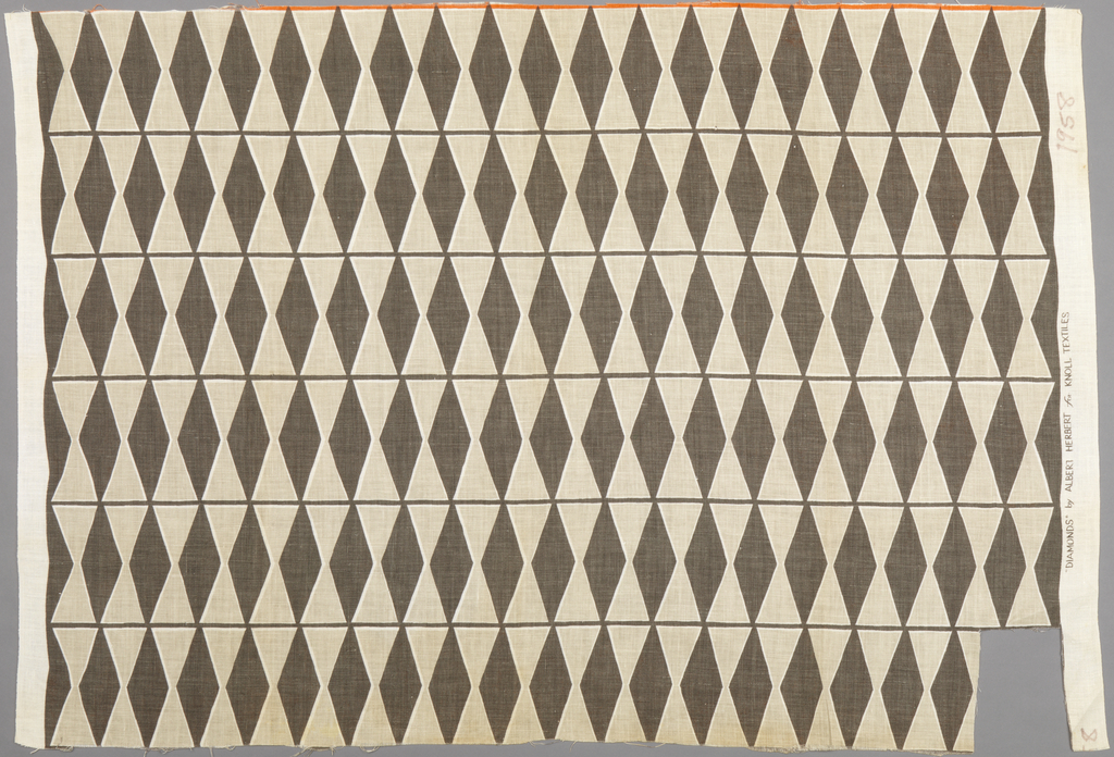 Tangent diamonds intersected by narrow white stripes, in Brown colorway.