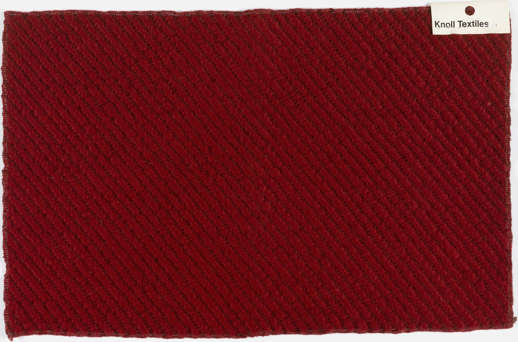 Heavy twill with strong, irregular diagonal ribs, in deep cerise red.