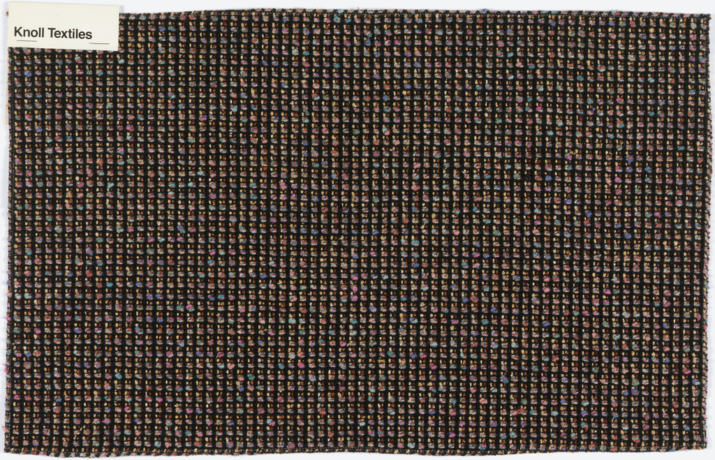 Tweed with black warps and wefts alternating a narrow copper-colored yarn with one in mixed pastels.