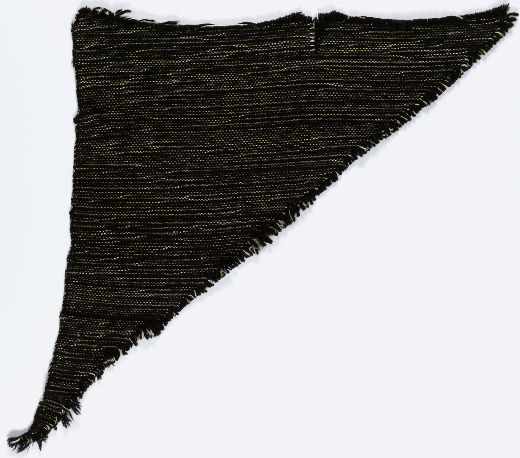 Tweedy handwoven in black and white with black plastic.