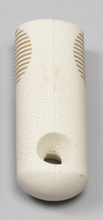 White handle for peeper, rounded bottom of handle with hole (for hanging). Area for gripping has horizontal striations on each side.