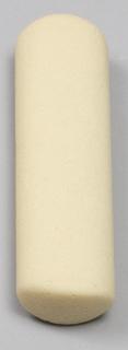 Cyndrically-shaped piece of beige foam.