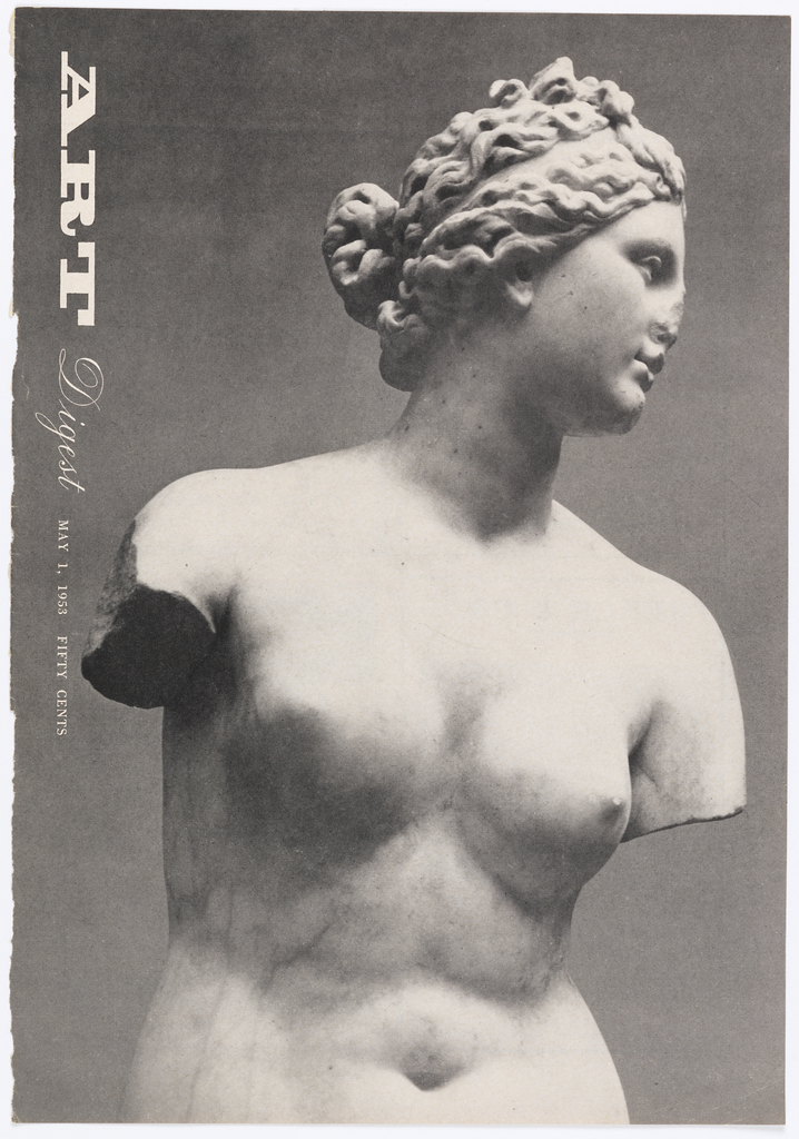 Photograph of marble statue on grey ground.