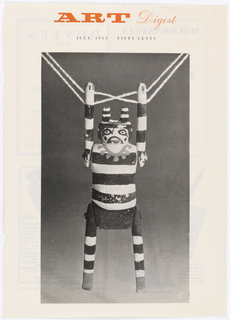 Cream background with black and white photograph of puppet hanging from string. Above center in red text: ART Digest.