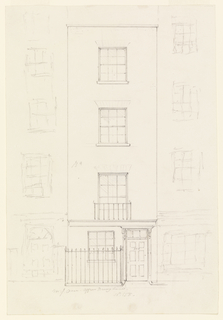 Vertical rectangle. Facade of a four story building with one window on each floor, entrance door at right, iron fence at left.