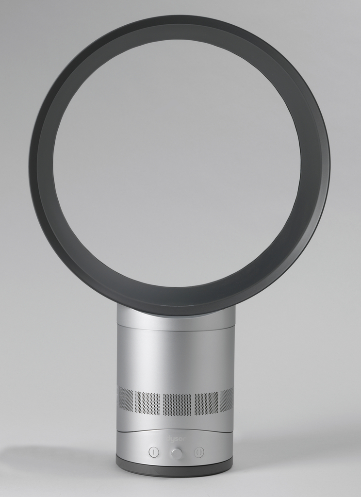 Form consisting of a circular aperture on a cylindrical base with controls on front.
