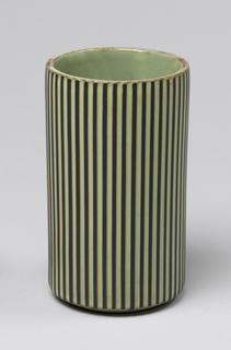 Cylindrical form with fluting; light green and brown glaze.