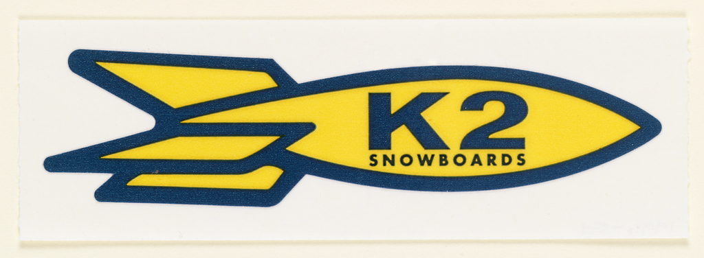 Sticker wtih a yellow oval shaped rocket with three tail fins outlined in navy blue.