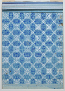 The blue panel shows a complicated white lozenge decoration, composed of floral elements, and having free spaces of vertical or horizontal extensions in alternate rows. An arabesque motif fills these, resulting in a reciprocal ornamentation. At top are three dark olive stripes upon blue.